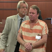 Brian Perry is escorted out of the courtroom after receiving his sentence Friday.
