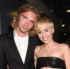 My Friend's Place representative Jesse and Miley Cyrus attend the 2014 MTV Video Music Awards at The Forum on August 24 in Inglewood, Calif.