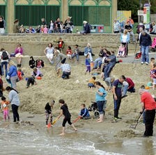 Treasure hunters dig for gold bars at low tide in the outer harbour in Folkestone, Great Britain on Aug. 29.