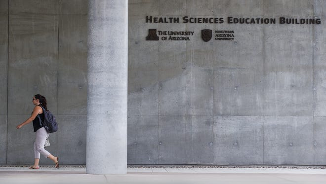 Arizona Board of Regents says no further inquiry is needed into the University of Arizona's Phoenix medical school, but it refuses to release the report on the probe.