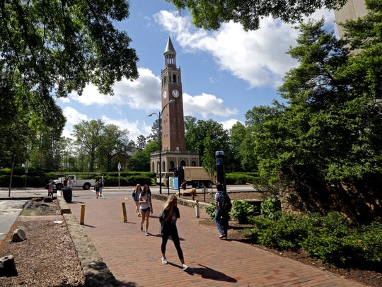 The Bell Tower looms over students on campus at the