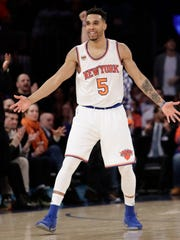 Knicks' Courtney Lee (5) reacts after scoring during