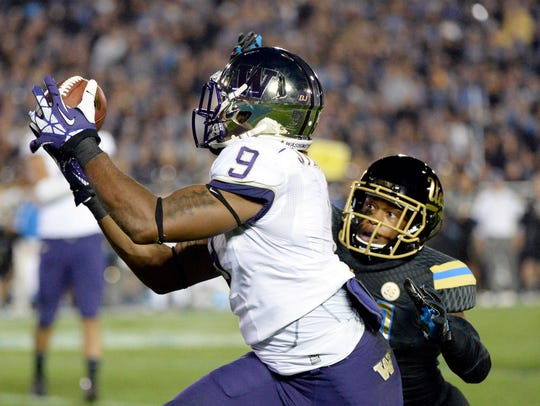 Damore'ea Stringfellow catches a pass against UCLA