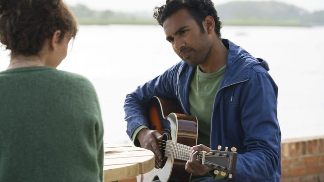 """Lily James, left, and Himesh Patel star in """"Yesterday."""" The movie was the Cinderella of the box office over the weekend."""