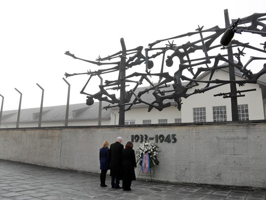 U.S. Vice President Mike Pence, center, his wife Karen, right, and his daughter Charlotte commemorate the victims of the Nazi terror during a visit to the former Nazi concentration camp in Dachau near Munich, southern Germany, Sunday, Feb. 19, 2017, one day after he attended the Munich Security Conference. (AP Photo/Matthias Schrader)