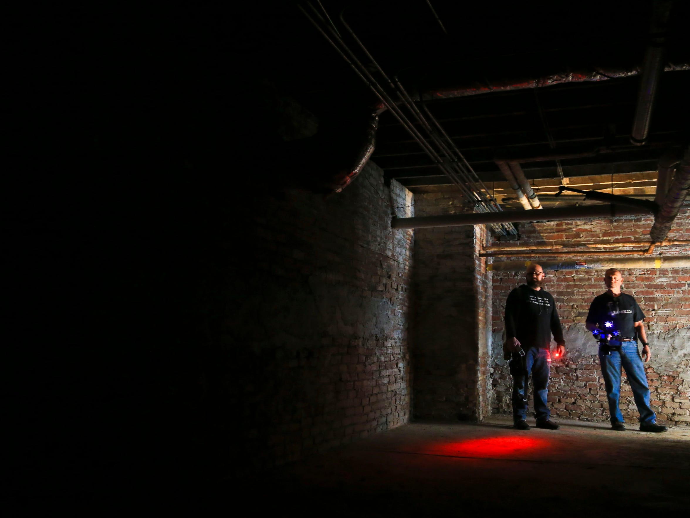 Paranormal investigators Matthew Jackson, left, and