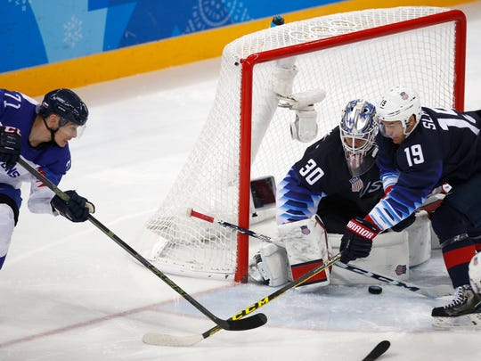 Goalie Ryan Zapolski (30) and Jim Slater (19), of the United States, guard the goal as Marek Daloga (71), of Slovakia, shoots during the third period of the qualification round of the men's hockey game at the 2018 Winter Olympics in Gangneung, South Korea, Tuesday, Feb. 20, 2018. (AP Photo/Jae C. Hong)