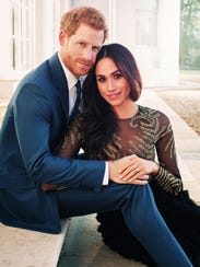 Prince Harry and Meghan Markle pose for one of two official engagement photos at Frogmore House in December 2017 in Windsor. She is wearing an $80,000 dress by Ralph & Russo.