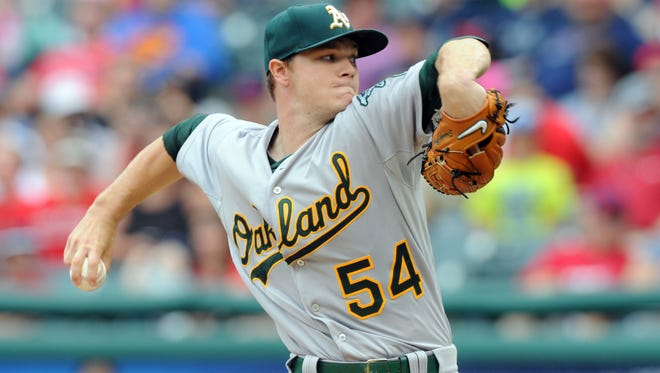 Oakland Athletics starting pitcher Sonny Gray (54) throws a pitch during the first inning against the Cleveland Indians at Progressive Field.