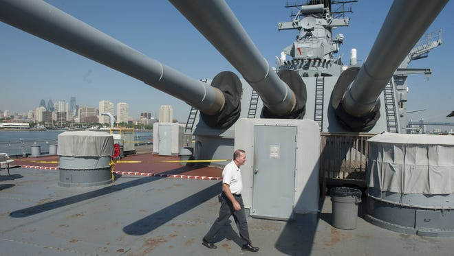 Jack Willard, Sr. Vice President Marketing & Sales, walks on the deck of the Battleship New Jersey which is being used to house people during the papal visit. Friday, September 18, 2015.