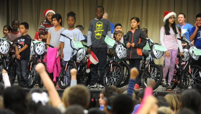 Thirty Ortiz Elementary School students with perfect attendance received bikes donated by Academy Sports and Outdoors on Thursday, Dec. 15, 2016.