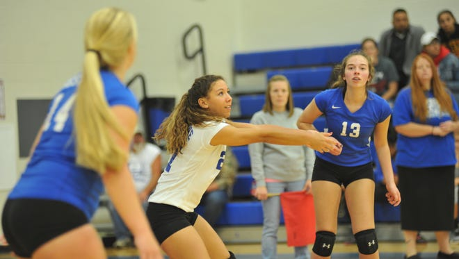 Desi Naveja (center) and Lauryn Tadda (right) are two returners for the Lady Bulldogs.