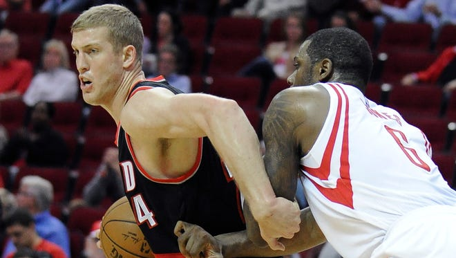 Portland Trail Blazers' Mason Plumlee (24) tries to fend off Houston Rockets' Terrence Jones (6) in the first half of an NBA basketball game Wednesday, Nov. 18, 2015, in Houston.