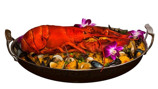 Chef Ercan Ekinci prefers to make his paella with chicken and seafood.