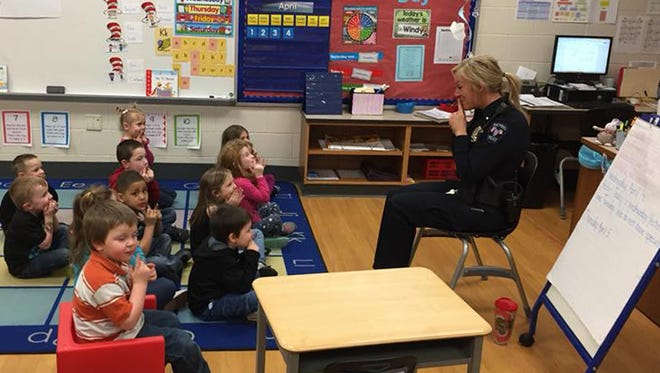 Bucyrus PoliceOfficer Jo Stahl (right) works with students in the Bucyrus City School Districtpreschool program to teach them lifelong safety skills. This is one of many roles Officer Stahl fills as the district's School Resource Officer.