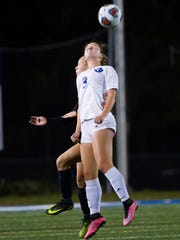 Olivia Buschle, from Barron Collier High School, heads the ball during the Class 3A regional semifinal against North Fort Myers High School at Barron Collier High School on Tuesday, January 31, 2017 in East Naples.