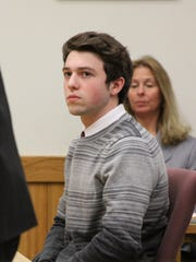 Nicklaus Lefebvre listens to his attorney Rolland Sizemore