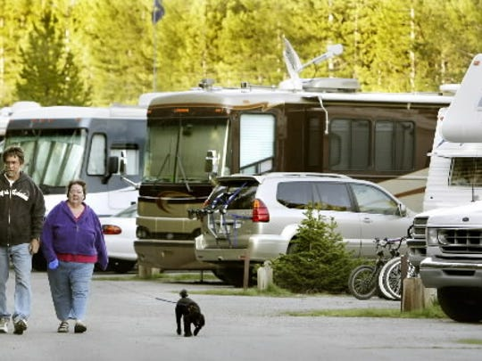 Russ and Celeste Faust, of Denver, walk their dogs