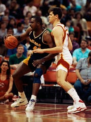 Indiana Pacers forward LaSalle Thompson, left, is guarded by Atlanta Hawks center Blair Rasmussen on Friday, March 7, 1992.