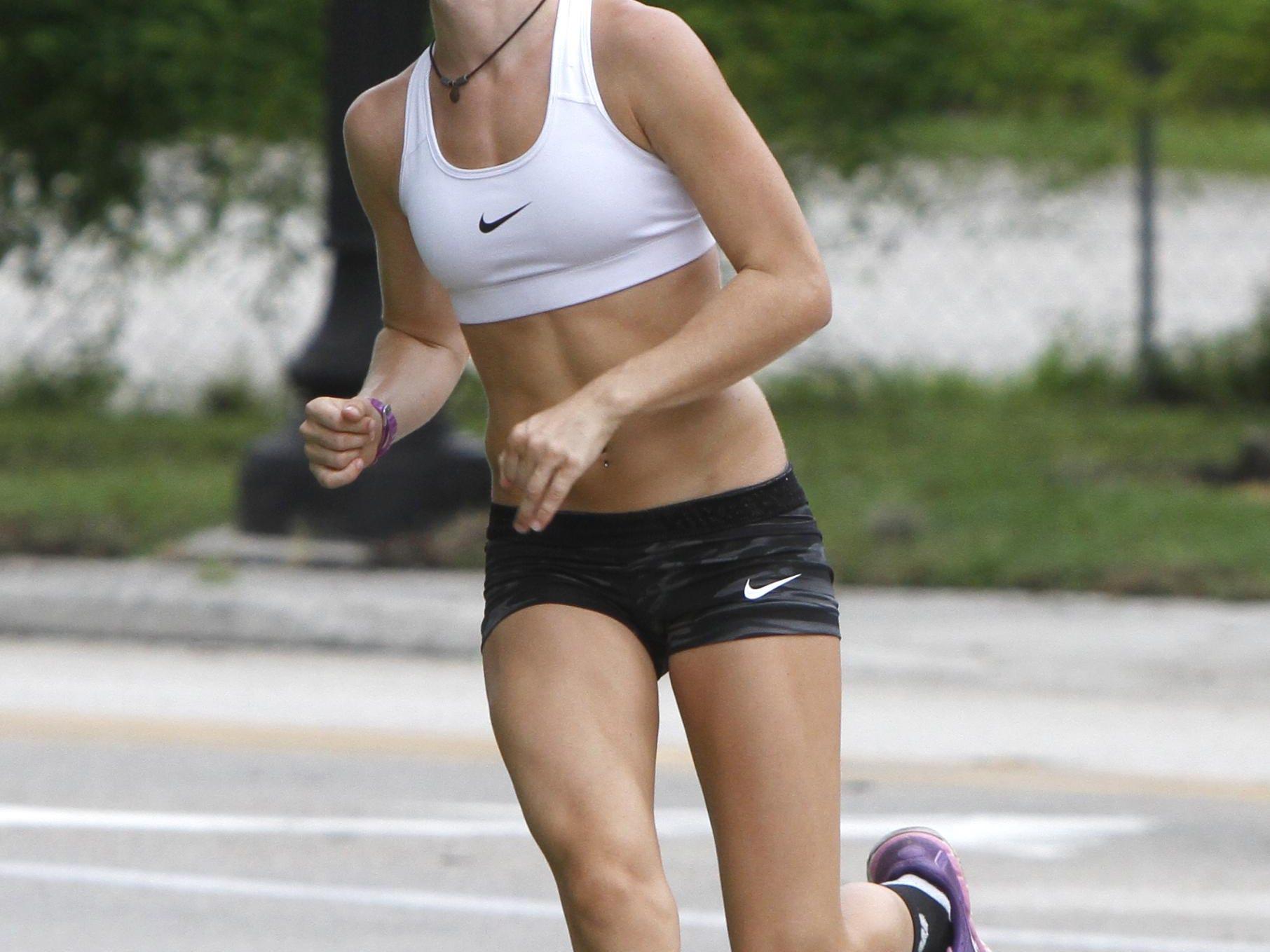 Fort Myers High School cross country runner Kristlin Gear runs near McGregor Avenue in Fort Myers Friday, August 28.
