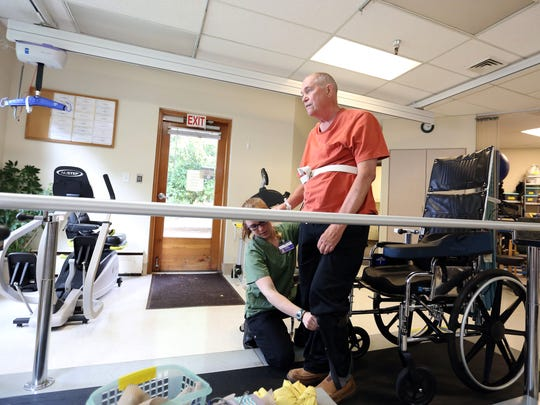 Physical Therapist Karina Montgomery works with Dr.