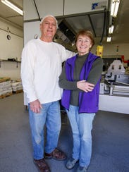 Owners Chris and Barb Pinahs pose for a photo at StoneBank