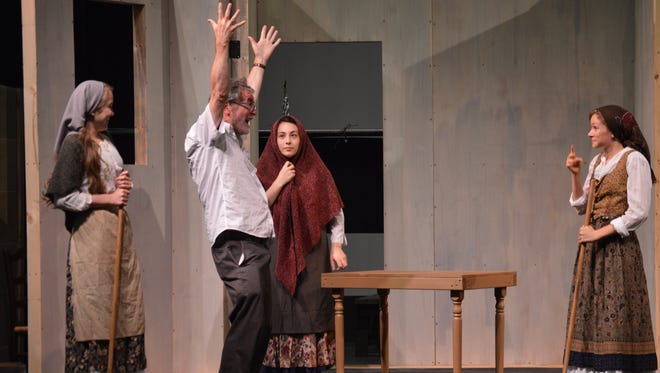 """Jim Lortz directs cast members of the Summer Youth Musical Theatre Workshop's production of """"Fiddler on the Roof."""""""