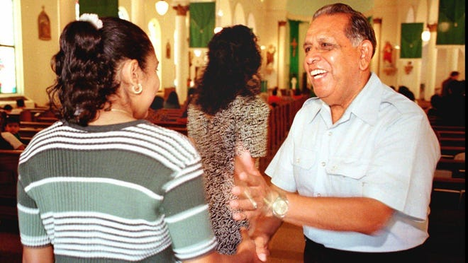 Joe Sanchez greets members of Our Lady of Guadalupe Catholic Church in Austin on a Sunday morning before Mass in 1997.