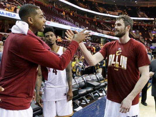Cleveland Cavaliers' Tristan Thompson, left, and Kevin Love celebrate the team's 115-84 victory over the Toronto Raptors in Game 1 of the NBA basketball Eastern Conference finals, Tuesday, May 17, 2016, in Cleveland. (AP Photo/Tony Dejak)