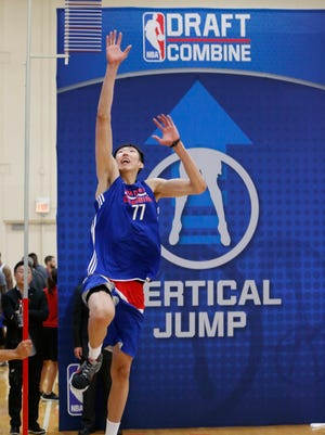 Zhou Qi, from China, participates in the NBA draft basketball combine recently.