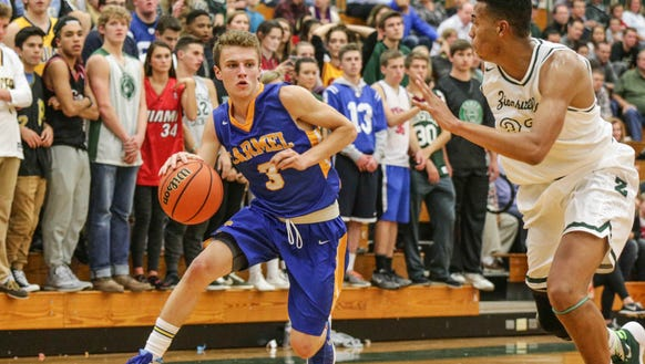 Carmel's #3 Cole Jenkins drives to the land past Zionsville's