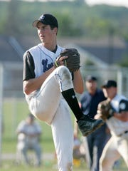 Oak Creek pitcher Tony Butler on his way to pitching a shutout over Cudahy in the 2005 WIAA playoffs.