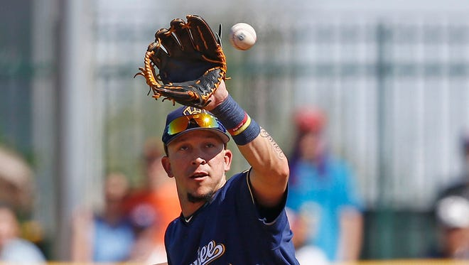 Hernán Pérez fields a ground ball during a spring training game March 19. Last spring, Pérez was sent to Class AAA Colorado Springs at the end of camp, but he didn't stay there long.