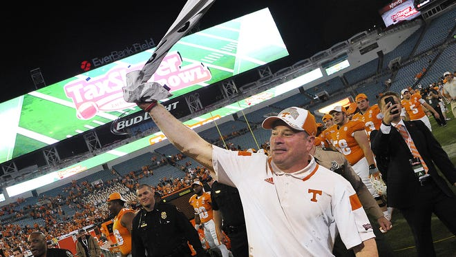 Coach Butch Jones celebrates after Tennessee beat Iowa in the TaxSlayer Bowl in Jacksonville, Fla., on Jan. 2, 2015.