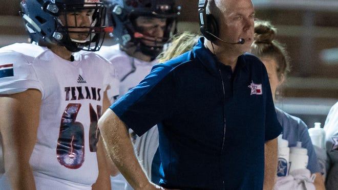 Wimberley head coach Doug Warren led the Texans to a season-opening 24-22 win over Canyon Lake Friday.