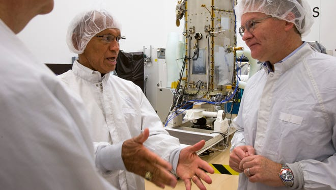 NASA Administrator Charles Bolden, left, is briefed by Orbital Sciences CEO David W. Thompson at Orbital's satellite manufacturing facility in Gilbert, Ariz., on Friday, Aug. 9, 2013 on the progress of the OCO-2 satellite.
