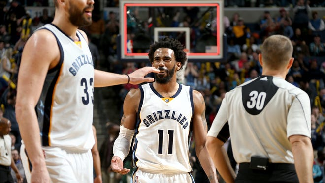 Memphis Grizzlies Marc Gasol and Mike Conley celebrate a Vince Carter three-point basket against the Milwaukee Bucks at FedExForum.