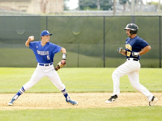 Horseheads shortstop Trey Princiotto throws to first