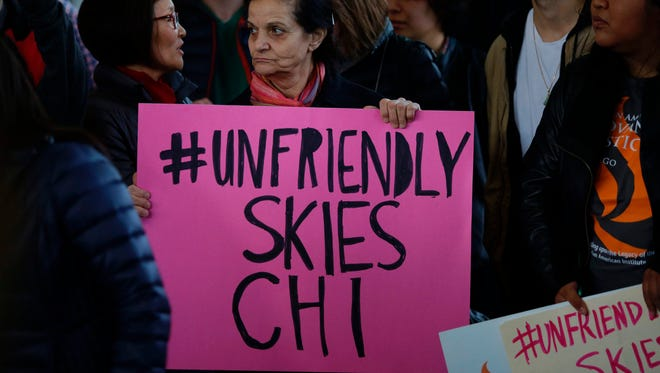 Demonstrators protest against United Airlines at Chicago's O'Hare International Airport on April 11, 2017.