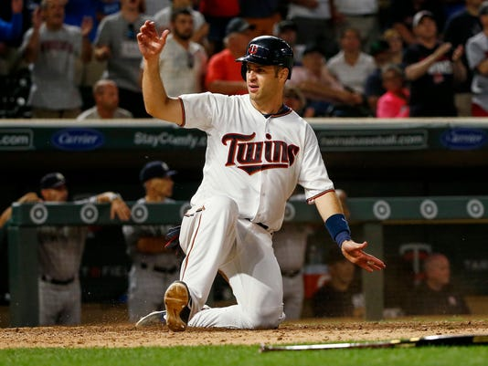 Minnesota Twins' Joe Mauer scores against the New York Yankees during the eighth inning of a baseball game Monday, July 17, 2017, in Minneapolis. The Twins won 4-2. (AP Photo/Bruce Kluckhohn)