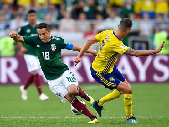 Mexico's Andres Guardado, left, and Sweden's Mikael Lustig challenge for the ball during the group F match between Mexico and Sweden, at the 2018 soccer World Cup in the Yekaterinburg Arena in Yekaterinburg , Russia, Wednesday, June 27, 2018. (AP Photo/Martin Meissner)