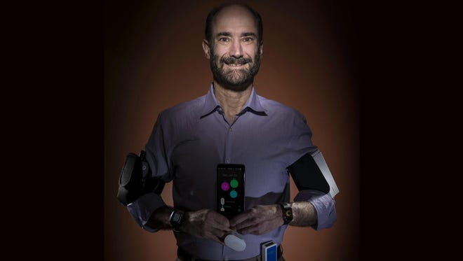 Michael Snyder, professor and chair of genetics at the Stanford University School of Medicine, sports wearable gadgets. Wearable gadgets gave Snyder an early warning that he was getting sick before he ever felt any symptoms of Lyme disease.