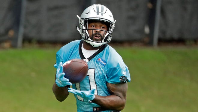 Carolina Panthers' Torrey Smith (11) catches a pass during practice at the NFL football team's facility in Charlotte, N.C., Tuesday, May 29, 2018.