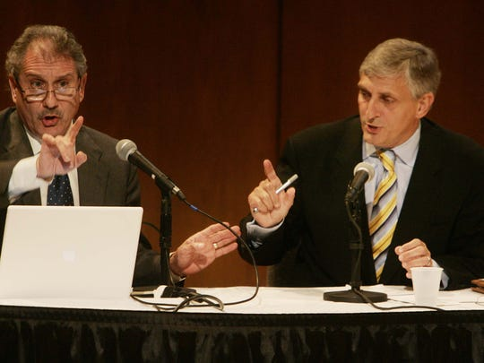 Heywood Sanders (left) and Butch Spyridon debate the new convention center during a community forum in Nashville, Tenn., Sunday, May 31, 2009.