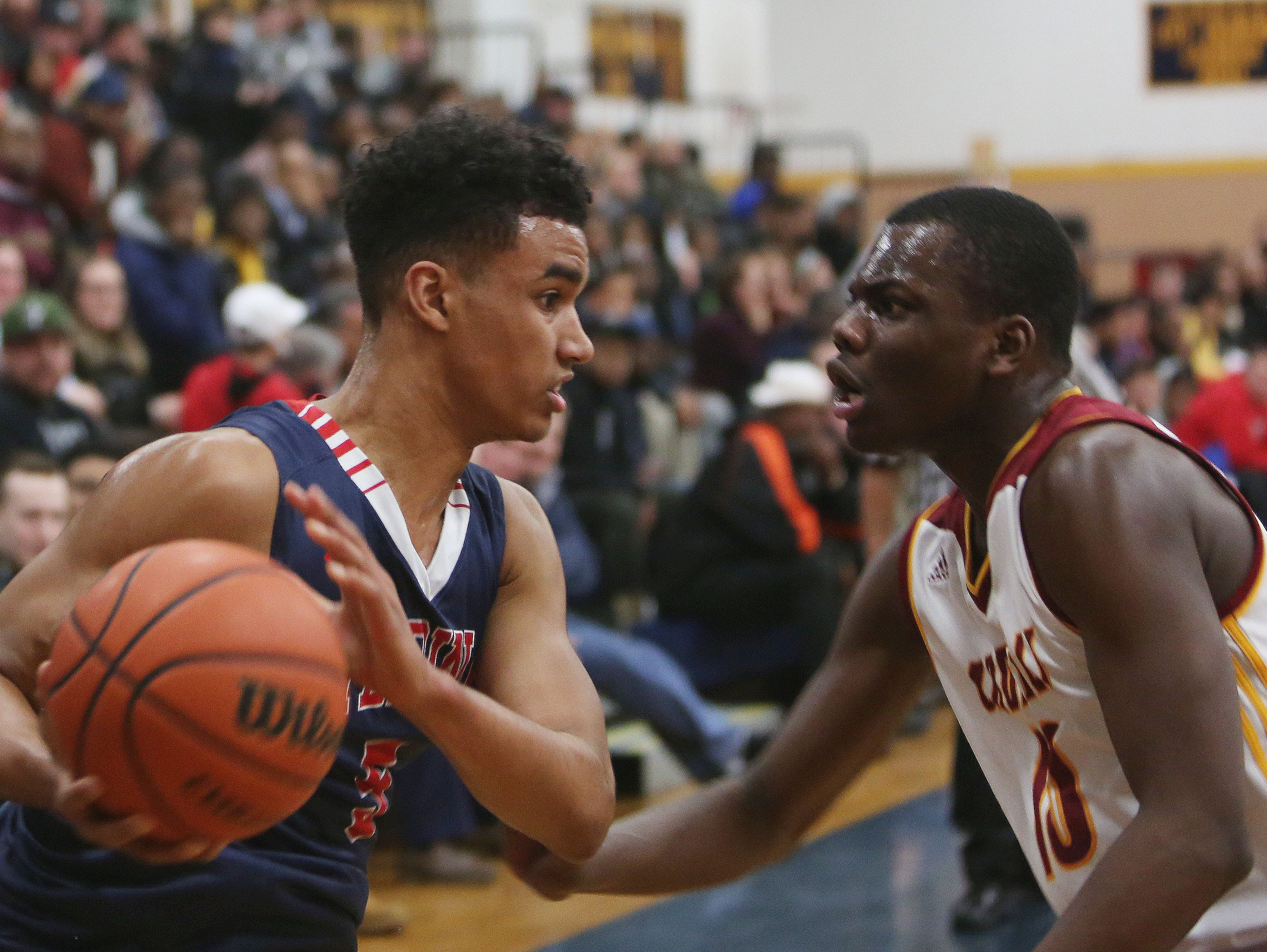 Stepinac's Jordan Tucker (5) tries to get around Cardinal Hayes' Quran Brockhouse (10) during the CHSAA Archdiocesan tournament semifinal at Mount Saint Michael Academy in the Bronx Feb. 23, 2016.