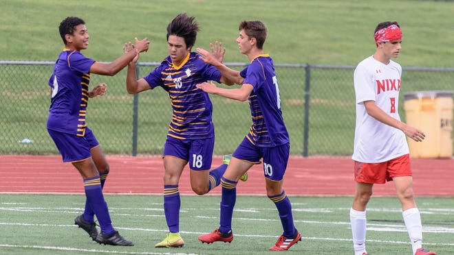 Hickman's Jaiden Taing (18) celebrates his goal with teamates Mohamed Lehmidi (6) and Ilhan Dervisevic (10) during a home match against Nixa on Saturday at Hickman High School.