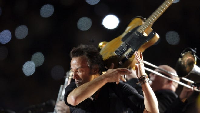 Keep your eye on that guitar, Bruce Springsteen.