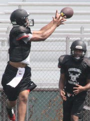 Livonia Churchill receiver Andrew Ward looks in a pass
