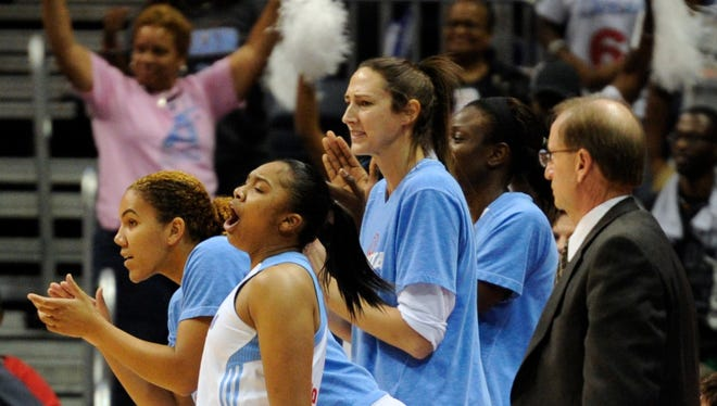 Atlanta Dream players on the bench including guard Alex Bentley (2) react to the play late in the game against the Indiana Fever during the second half at Philips Arena. The Dream defeated the Fever 84-79.