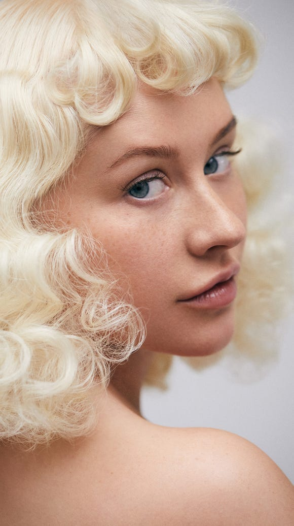 A curly blond wig was her only accessory.